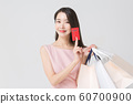 Happy single woman life, an attractive smiling woman holding shopping bags 417 60700900