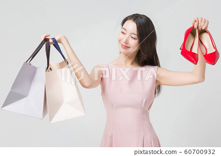 Happy single woman life, an attractive smiling woman holding shopping bags 352 60700932