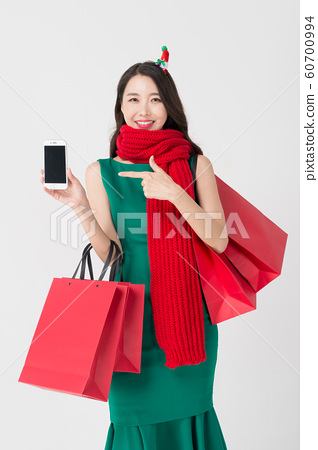 Happy single woman life, an attractive smiling woman holding shopping bags 186 60700994