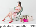Happy single woman life, an attractive smiling woman holding shopping bags 276 60700999