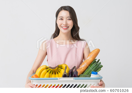 Happy single woman life, an attractive smiling woman holding shopping bags 374 60701026