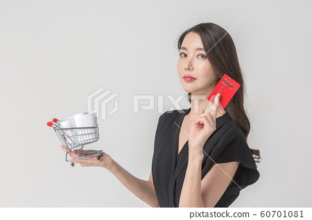 Happy single woman life, an attractive smiling woman holding shopping bags 112 60701081