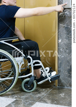 Disabled handicapped man sitting on wheelchair 058 60702124