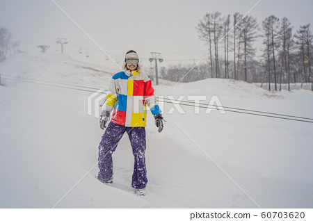 A man throws snow and enjoys the winter, outside 60703620
