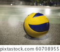 Low angle view of yellow-blue volleyball on the floor in court. 60708955
