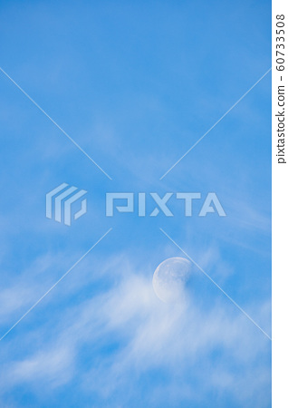 Moon and white clouds in the blue sky 60733508