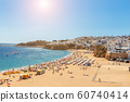Famous tourist beach with fishermen in Albufeira, Portugal. 60740414