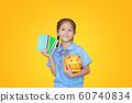 Smiling Asian little girl in school uniform 60740834
