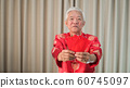 Asian Chinese senior Chinese new year red envelop 60745097