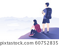 Hiking couple standing on the rock and looking at 60752835
