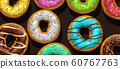 colorful donuts on black background 60767763