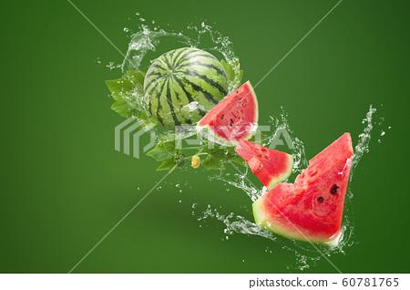 Water splashing on Sliced of watermelon on green 60781765