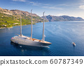 Luxury yacht and blue sea at colorful sunset in summer. Aerial view of big modern sail boat 60787349