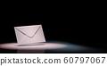 White Envelope Spotlighted on Black Background 60797067