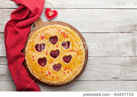 Raspberry cake for Valentine's Day with hearts 60807728