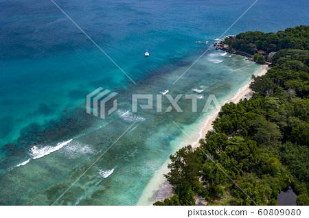 waves on reef in seychelles paradise beach aerial 60809080