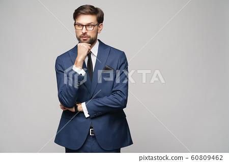 Studuo shot of thinking businessman wearing suit 60809462