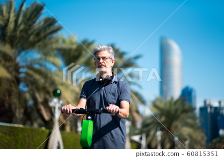 Senior using electric scooter for transportation 60815351