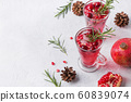 Pomegranate Christmas cocktail with rosemary. 60839074