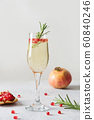 Pomegranate Christmas cocktail with rosemary 60840246