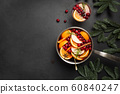 Christmas hot mulled wine on black table 60840247