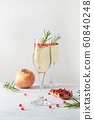 Pomegranate Christmas cocktail with rosemary 60840248