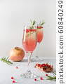 Pomegranate Christmas cocktail with rosemary 60840249