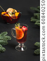 Christmas hot mulled wine on black table 60840250