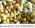 Yellow cocoon Natural products, silk cocoon texture background 60858693