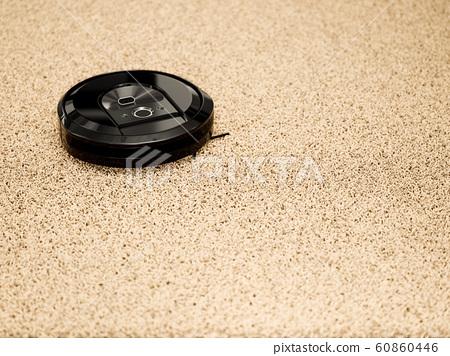 Robotic vacuum cleaner on a carpet floor 60860446