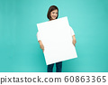 Smiling happy Asian woman holding and standing 60863365