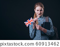 Thoughtful Girl With British Flag Touching Her Lip With Glasses Earpiece 60913462