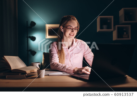 Enthusiastic Ginger Student Girl Using a Laptop 60913537