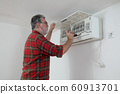 Worker repairing air condition equipment 60913701
