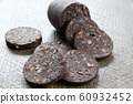 Blood pudding sausage on wooden background 60932452