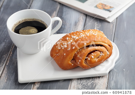 Cinnamon roll and a cup of coffee 60941878