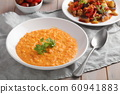 Pumpkin soup decorated with basil in a vegetarian 60941883