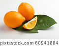 Orange colored lemons on a cutting board 60941884