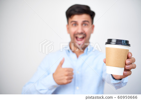 Businessman with hot morning coffee 60950666