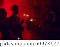 Blurred Image of People in Nightclub 60973122