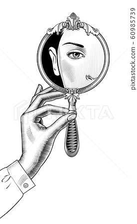 Female hand holding a round decorative mirror with a reflection 60985739