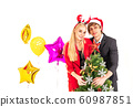 Happiness couple enjoy posing with colorful balloons and christmas tree 60987851