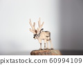 Wood carving reindeer 60994109