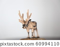 Wood carving reindeer 60994110