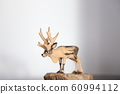 Wood carving reindeer 60994112