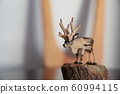 Wood carving reindeer 60994115
