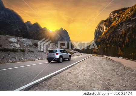 Idyllic mountain road through the Dolomites 61001474