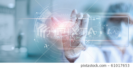 Doctor, surgeon analyzing patient brain testing result and human anatomy on technological digital futuristic virtual interface, digital holographic, innovative in science and medicine concept 61017653