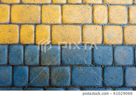 yellow and blue cobbles of pavement texture 61029066