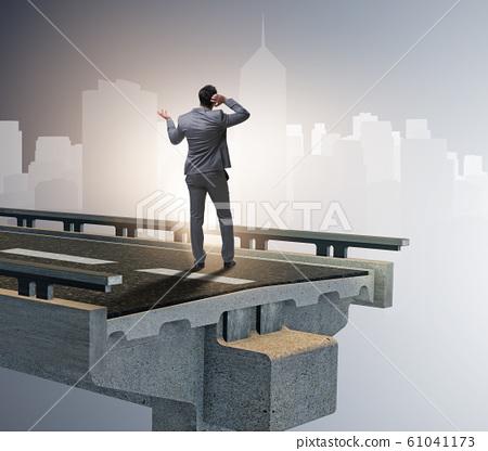 Businessman in uncertainty concept with broken bridge 61041173